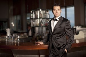6378265-handsome-young-man-in-a-black-tuxedo-at-a-round-bar-holding-whisky-in-his-hand-shallow-depth-of-fiel