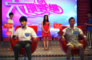 "A participant introduces herself during the recording of an episode of ""Meet you on Saturday"", a matchmaking TV programme, in Shanghai"