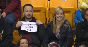 Guy-Pulls-Out-Sign-On-Gophers-Kiss-Cam