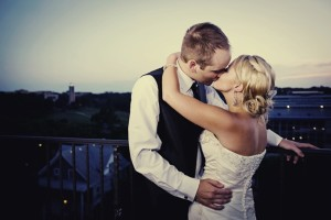 bride-groom-kiss-at-end-of-wedding-reception-night.original