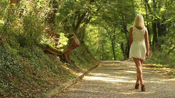 Blonde Girl Walking on a Forest Road preview image